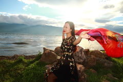 Asian Chinese Young girl enjoy sunshine by erhai, enjoy peaceful life. Asian Chinese Young beautiful woman enjoy free time, beautiful graceful girl, healthy Stock Photo