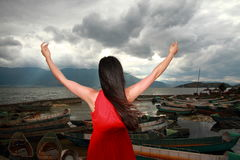 Asian Chinese Young girl hug sunshine by erhai, enjoy peaceful life. Asian Chinese Young beautiful woman enjoy free time, beautiful graceful girl, healthy living Royalty Free Stock Images