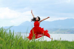 Asian Chinese Young girl jump by beach, enjoy peaceful life Stock Photo