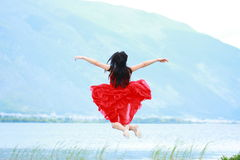 Asian Chinese Young girl jump by beach, enjoy peaceful life Stock Images