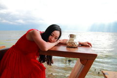 Asian Chinese Young girl rest by erhai, enjoy peaceful life. Asian Chinese Young beautiful woman enjoy free time, beautiful graceful girl, healthy living concept Stock Images