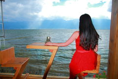 Asian Chinese Young girl see landscape by Lugu lake, enjoy peaceful life. Asian Chinese Young beautiful woman enjoy free time, beautiful graceful girl, healthy Royalty Free Stock Images