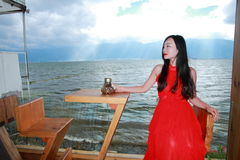Asian Chinese Young girl see landscape by Lugu lake, enjoy peaceful life. Asian Chinese Young beautiful woman enjoy free time, beautiful graceful girl, healthy Stock Photo