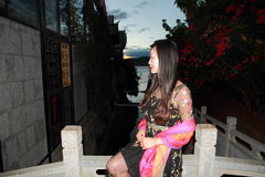 Asian Chinese Young girl sit on a bridge, enjoy quiet and peaceful life by Yunnan erhai. Asian Chinese Young beautiful woman enjoy free time, beautiful graceful Stock Photos