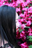 Asian Chinese Young girl smell faint aroma of flowers. Asian Chinese Young beautiful woman enjoy free time, beautiful graceful girl, healthy living concept, pure Stock Photo