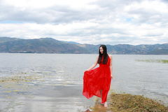 Asian Chinese Young girl walk by beach, enjoy peaceful life. Asian Chinese Young beautiful woman enjoy free time, beautiful graceful girl, healthy living concept Royalty Free Stock Image