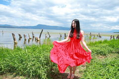 Asian Chinese Young girl walk by beach, enjoy peaceful life. Asian Chinese Young beautiful woman enjoy free time, beautiful graceful girl, healthy living concept Stock Images