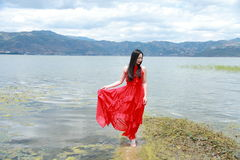 Asian Chinese Young girl walk by beach, enjoy peaceful life. Asian Chinese Young beautiful woman enjoy free time, beautiful graceful girl, healthy living concept Stock Image