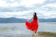 Asian Chinese Young girl walk by beach, enjoy peaceful life. Asian Chinese Young beautiful woman enjoy free time, beautiful graceful girl, healthy living concept Royalty Free Stock Photos