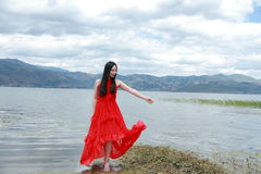 Asian Chinese Young girl walk by beach, enjoy peaceful life. Asian Chinese Young beautiful woman enjoy free time, beautiful graceful girl, healthy living concept Royalty Free Stock Photography