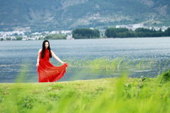 Asian Chinese Young girl walk by beach, enjoy peaceful life. Asian Chinese Young beautiful woman enjoy free time, beautiful graceful girl, healthy living concept Stock Photography