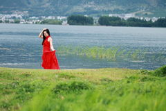 Asian Chinese Young girl walk by beach, enjoy peaceful life. Asian Chinese Young beautiful woman enjoy free time, beautiful graceful girl, healthy living concept Royalty Free Stock Photo