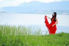 Asian Chinese Young girl walk by beach, enjoy peaceful life. Asian Chinese Young beautiful woman enjoy free time, beautiful graceful girl, healthy living concept Stock Photo