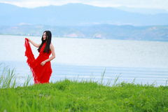 Asian Chinese Young girl walk by beach, enjoy peaceful life. Asian Chinese Young beautiful woman enjoy free time, beautiful graceful girl, healthy living concept Stock Photos