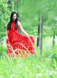 Asian Chinese Young girl walk in forest, enjoy peaceful life. Asian Chinese Young beautiful woman enjoy free time, beautiful graceful girl, healthy living Royalty Free Stock Image