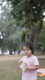 Asian chinese young toddler eating breakfast by herself Stock Photo