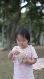 Asian chinese young toddler eating sandwiches by herself Royalty Free Stock Images