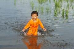 Asian chlidren, water, little boy, danger Stock Photo