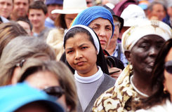 Women, Religion, Asian Christian Nun, Human Races. Asian Christian nun surrounded by other women of different races and ages. May 13th Pilgrimage, Fatima Stock Image