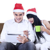 Asian christmas couple shopping online Stock Photo