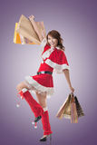 Asian Christmas girl hold shopping bags Royalty Free Stock Photography