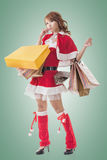Asian Christmas girl hold shopping bags Royalty Free Stock Photos
