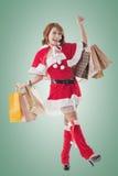 Asian Christmas girl hold shopping bags Stock Photo