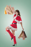 Asian Christmas girl hold shopping bags Royalty Free Stock Photo
