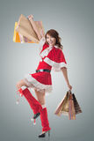 Asian Christmas girl hold shopping bags Royalty Free Stock Image