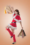 Asian Christmas girl hold shopping bags Stock Images
