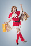 Asian Christmas girl hold shopping bags Royalty Free Stock Images