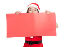 Asian Christmas girl with Santa Claus clothes with blank sign Stock Images