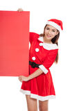 Asian Christmas girl with Santa Claus clothes with blank sign Royalty Free Stock Images