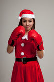Asian Christmas girl with Santa Claus clothes and  boxing glove Stock Image