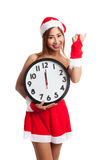 Asian Christmas girl in Santa Claus clothes and clock at midnigh Stock Photo
