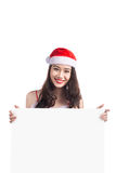 Asian Christmas girl with Santa Claus clothes holding blank sign Stock Photo