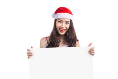 Asian Christmas girl with Santa Claus clothes holding blank sign Royalty Free Stock Photo
