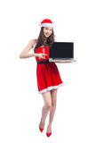 Asian Christmas girl with Santa Claus clothes holding laptop iso Stock Photo
