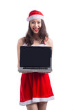 Asian Christmas girl with Santa Claus clothes holding laptop iso Royalty Free Stock Photo