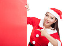 Asian Christmas girl with Santa Claus clothes point to blank sig Stock Photos