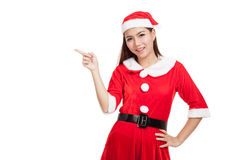 Asian Christmas girl with Santa Claus clothes point to blank spa Stock Photography
