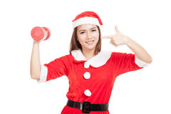 Asian Christmas girl with Santa Claus clothes point to red dumbb Royalty Free Stock Photos
