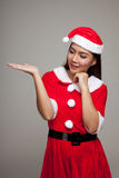 Asian Christmas girl with Santa Claus clothes present space on h Royalty Free Stock Photos