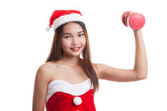 Asian Christmas girl with Santa Claus clothes and red dumbbell. Stock Images