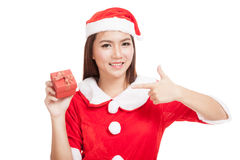Asian Christmas girl with Santa Claus clothes and red gift box Stock Image