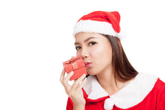 Asian Christmas girl with Santa Claus clothes and red gift box Stock Photo