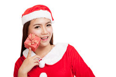 Asian Christmas girl with Santa Claus clothes and red gift box Royalty Free Stock Photography