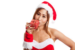 Asian Christmas girl with Santa Claus clothes and red gift box Royalty Free Stock Photos