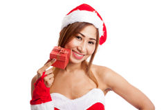Asian Christmas girl with Santa Claus clothes and red gift box Royalty Free Stock Image