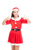 Asian Christmas girl with Santa Claus clothes show thumbs up Stock Photography